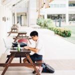 student sitting along