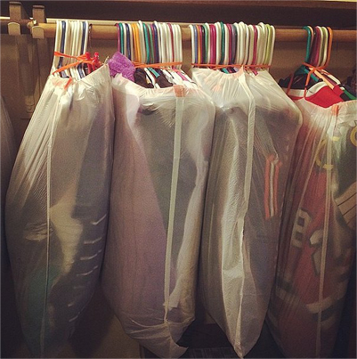 cover hanging clothes in trash bags