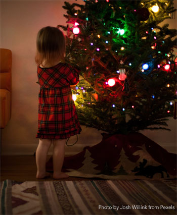 child at the Christmas tree